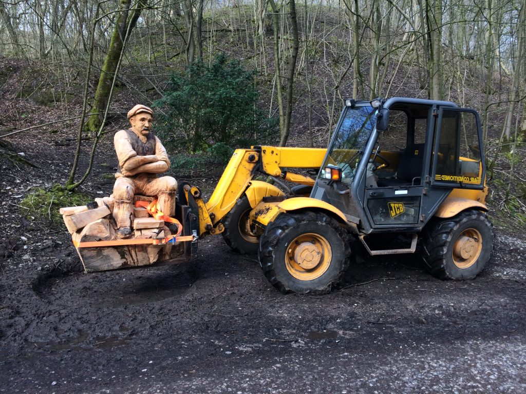 Machine moves woodland sculpture into position