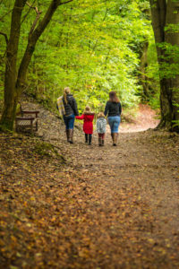 Family walking in Grinlow Woods
